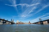 picture of brooklyn bridge  - Manhattan skyline view from Brooklyn between Brooklyn Bridge and Manhattan Bridge in New York City - JPG