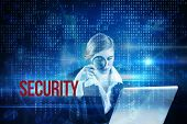 The word security and redhead businesswoman using her laptop against blue technology interface with binary code