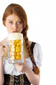 Oktoberfest girl drinking jug of beer on white background