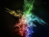 Colourful powder exploding isolated on black