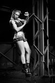 Young woman in uniform with skipping rope (monochrome version)