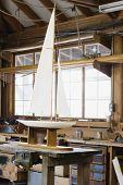 Model sailboat on table in workshop