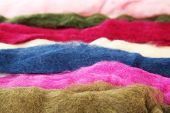 Multicolored wool for felting close up