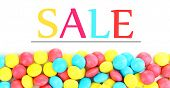 Sale concept. Color candies isolated on white