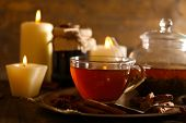 picture of teapot  - Composition with tea in cup and teapot and candles on table - JPG