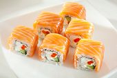 Roll with Cream Cheese, Salmon roe (ikura) and Cucumber inside. Salmon outside