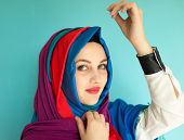 stock photo of middle eastern culture  - Beautiful Middle eastern girl with a scarf on red and blue - JPG