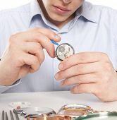 Watchmaker. Watch repair craftsman repairing watch