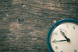 image of analog clock  - the closeup of analog retro alarm clock - JPG