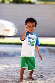 Little Boy Holding A Rock