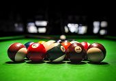 image of pool ball  - Billiard Balls. A Vintage style photo from a billiard balls in a pool table. Noise added for a film effect