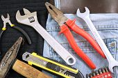 Toolkit in a blue jeans background