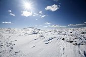 Beautiful winter landscape with snow, sunshine and blue sky