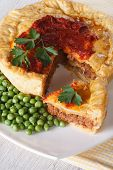 Sliced Meat Pie And Green Pea. Vertical Close-up