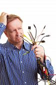 Man Holding Many Different Cables