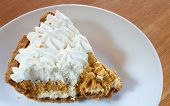 stock photo of fillies  - Pumpkin pie slice that has had its filliing whipped to be light - JPG