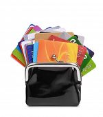 Lot of credit cards in purse isolated on white