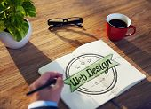 Man with Note Pad and Web Design Concept