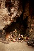 stock photo of phallus  - Pranang cave with many wooden phallus in Thailand - JPG