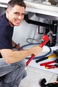 image of plumber  - Plumber man with tools in the kitchen - JPG