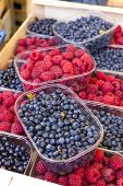raspberries and blueberries, market in Nyons, Rhone-Alpes, France