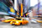 stock photo of cabs  - Blurry abstract photo of taxi cabs in Manhattan New York in motion - JPG