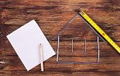 Shape Of A Home Building And Paper - Stock Image