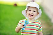 picture of cap gun  - happy little boy in cap with toy outdoors - JPG