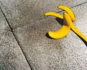 Banana skin on sidewalk