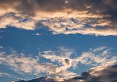 foto of wispy  - Wispy spotty clouds in summer heavenly sky