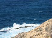 stock photo of breaker  - The rocks and the wave breakers of the Atlantic ocean at  Punto de Paso Chico on the island Fuerteventura belonging to Spain - JPG