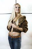 Beautiful Blonde Girl In Fur