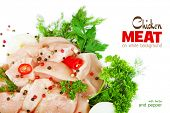 Slices of chicken meat on white background with herbs and pepper