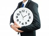 White Clock Holding In Businessman Hands Isolated