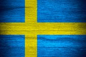 image of sweden flag  - Sweden flag or Swedish banner on wooden texture - JPG