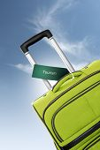 Tourism. Green Suitcase With Label