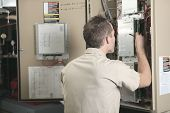 pic of air compressor  - A Air Conditioner Repair Man at work - JPG