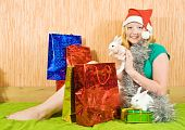 foto of tawdry  - teenager girl with Christmas gifts and two pet rabbits - JPG
