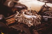 foto of carburetor  - Used carburetor from the fuel supply system of gasoline engine vintage - JPG