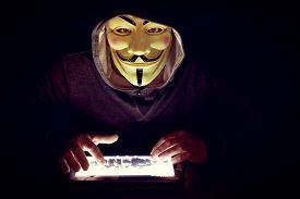 foto of terrorist  -  hacker with mask work to close terrorist sites - JPG
