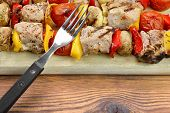 foto of braai  - BBQ Grilled Mixed With Vegetables Pork Kebabs On The Wooden Cutting Board - JPG