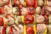 image of braai  - BBQ Grilled Mixed With Vegetables Pork Kebabs On The Wooden Cutting Board - JPG
