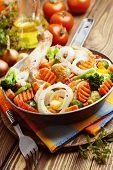 image of fried chicken  - Fried chicken with vegetables in the frying pan - JPG