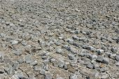 stock photo of cobblestone  - Industrial background  - JPG