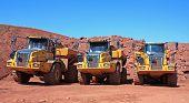 image of dump_truck  - dump trucks on a road construction site - JPG