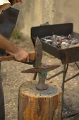 picture of moselle  - Medieval blacksmith forges iron during the traditional festival of Middle Ages in Moselle France  - JPG
