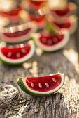 stock photo of jello  - Close up of strawberry jello served in lime peels  - JPG
