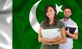 pic of pakistani flag  - Couple of young students with books over pakistan flag - JPG