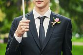 stock photo of boutonniere  - Very beautiful boutonniere on his jacket the groom - JPG