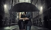foto of rainy season  - Elegant couple on rainy evening - JPG